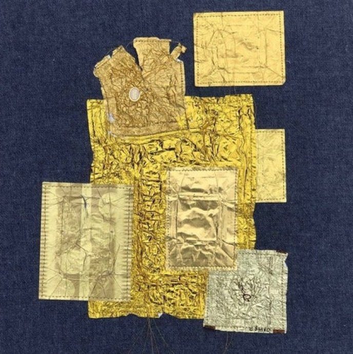 Collage, 2020 Wrappers, metal foil, threads on denim fabric, 12.5